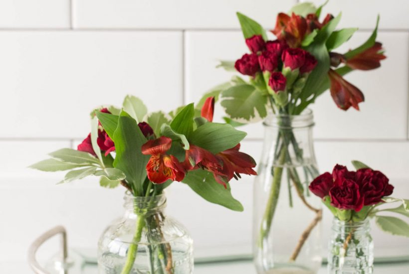 Here are some tips for how to make several mini arrangements that look classy and sophisticated out of inexpensive bunches of flowers.