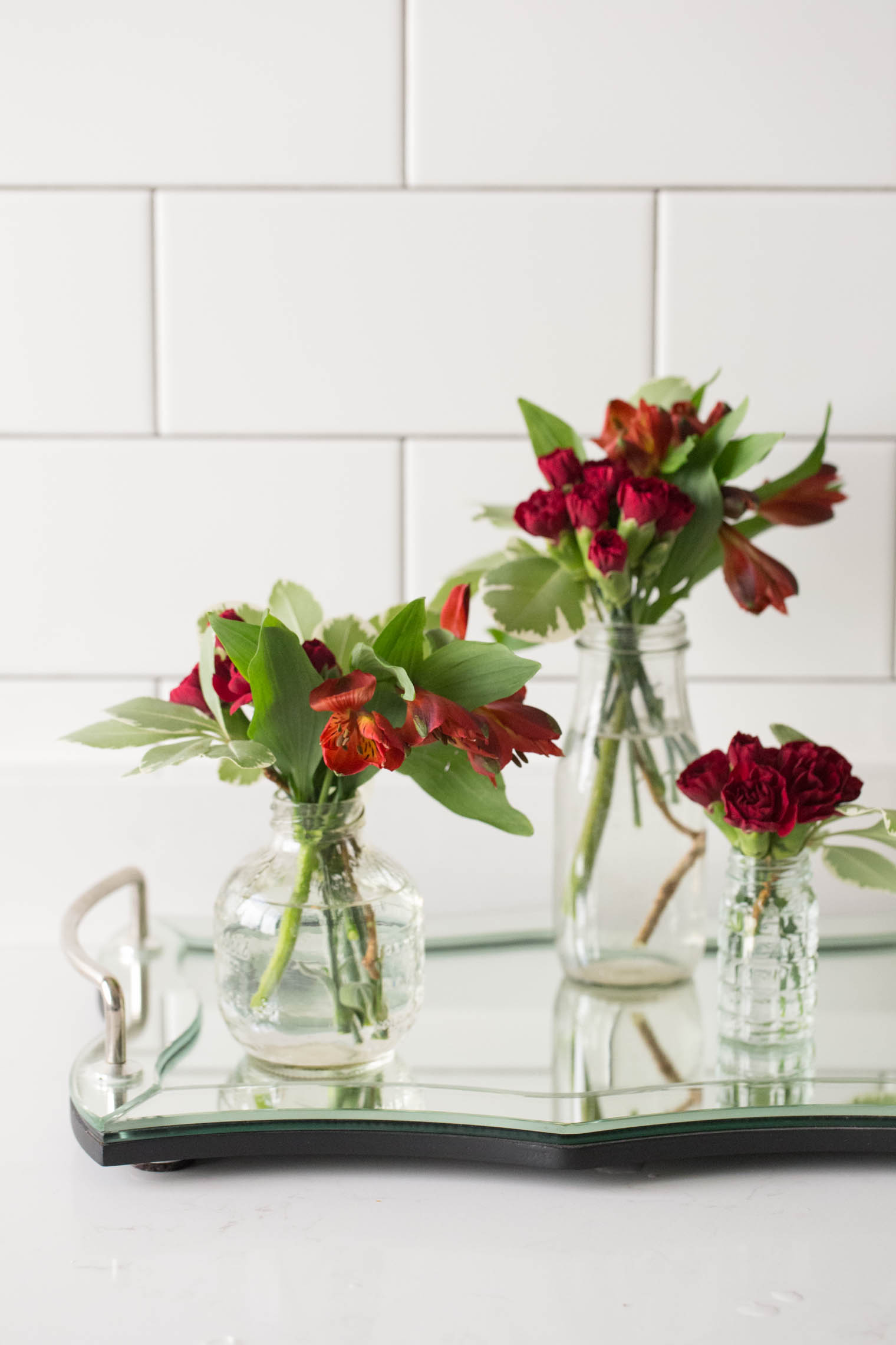 how to arrange flowers with multiple vases made to be lovely